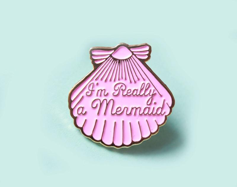 "Mermaid&nbsp;Shell Enamel Pin, $8.50, <a href=""https://www.etsy.com/listing/398673121/mermaid-pink-shell-enamel-pin-gifts-for?ga_order=most_relevant&amp;ga_search_type=all&amp;ga_view_type=gallery&amp;ga_search_query=mermaid&amp;ref=sr_gallery_13"" target=""_blank"">Etsy</a>"