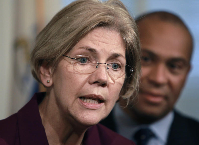FILE - In this Thursday, Nov. 8, 2012, file photo, U.S. Sen.-elect Elizabeth Warren, D-Mass., left, faces reporters as Mass. Gov. Deval Patrick, right, looks on during a news conference at the Statehouse, in Boston.  Senate Majority Leader Harry Reid wants Massachusetts Sen.-elect Elizabeth Warren to join the Banking Committee. A Senate Democratic official confirmed Tuesday, Dec. 4, 2012, that Warren's appointment was likely, but cautioned nothing was final until the Democratic caucus approves the move. The official spoke on condition of anonymity because no announcement has been made.(AP Photo/Steven Senne, File)