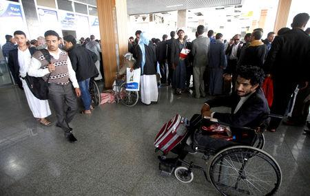 A wounded Houthi fighter is seen on a wheelchair at Sanaa airport during his evacuation from Yemen, December 3, 2018. REUTERS/Mohamed al-Sayaghi