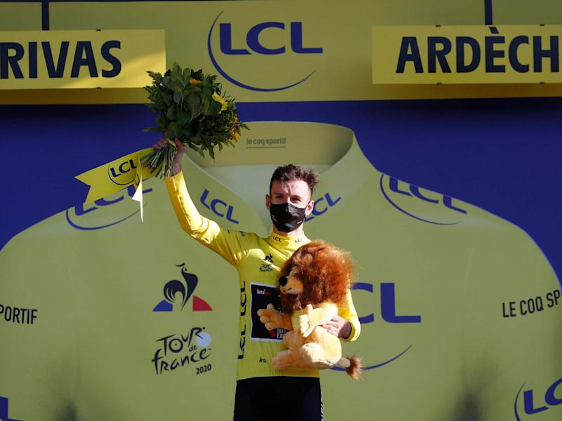 Adam Yates celebrates after earning the yellow jersey: Reuters