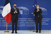 French President Emmanuel Macron, left and European Parliament President David Sassoli applaud during the Europe Day event and the Conference on the Future of Europe, Sunday, May 9, 2021 at the European Parliament in Strasbourg, eastern France. (Frederick Florin, Pool via AP)