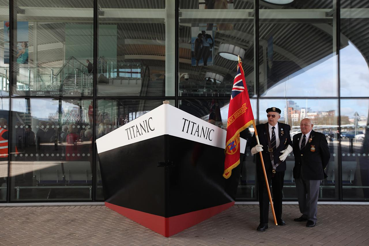 Former Merchant Navel officers Rod Burnet (L) and Douglas Piper stand beside a replica bow of RMS Titanic beside birth 43 and 44 at Southampton Dock during a Centenary Memorial on April 10, 2012 in Southampton, England. The births mark the departure point of RMS Titanic when it set sail one hundred years ago today. The maiden voyage of the ill-fated passenger liner Titanic ended when she sank after hitting an iceberg in the Atlantic on the night of April 14, 1911 with the loss of 1517 lives.  (Photo by Dan Kitwood/Getty Images)