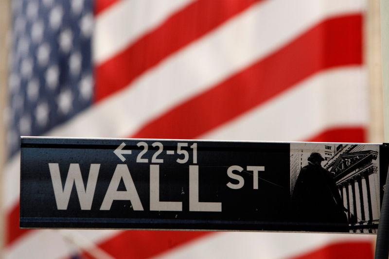 FILE PHOTO: Wall St. sign is seen outside NYSE in New York