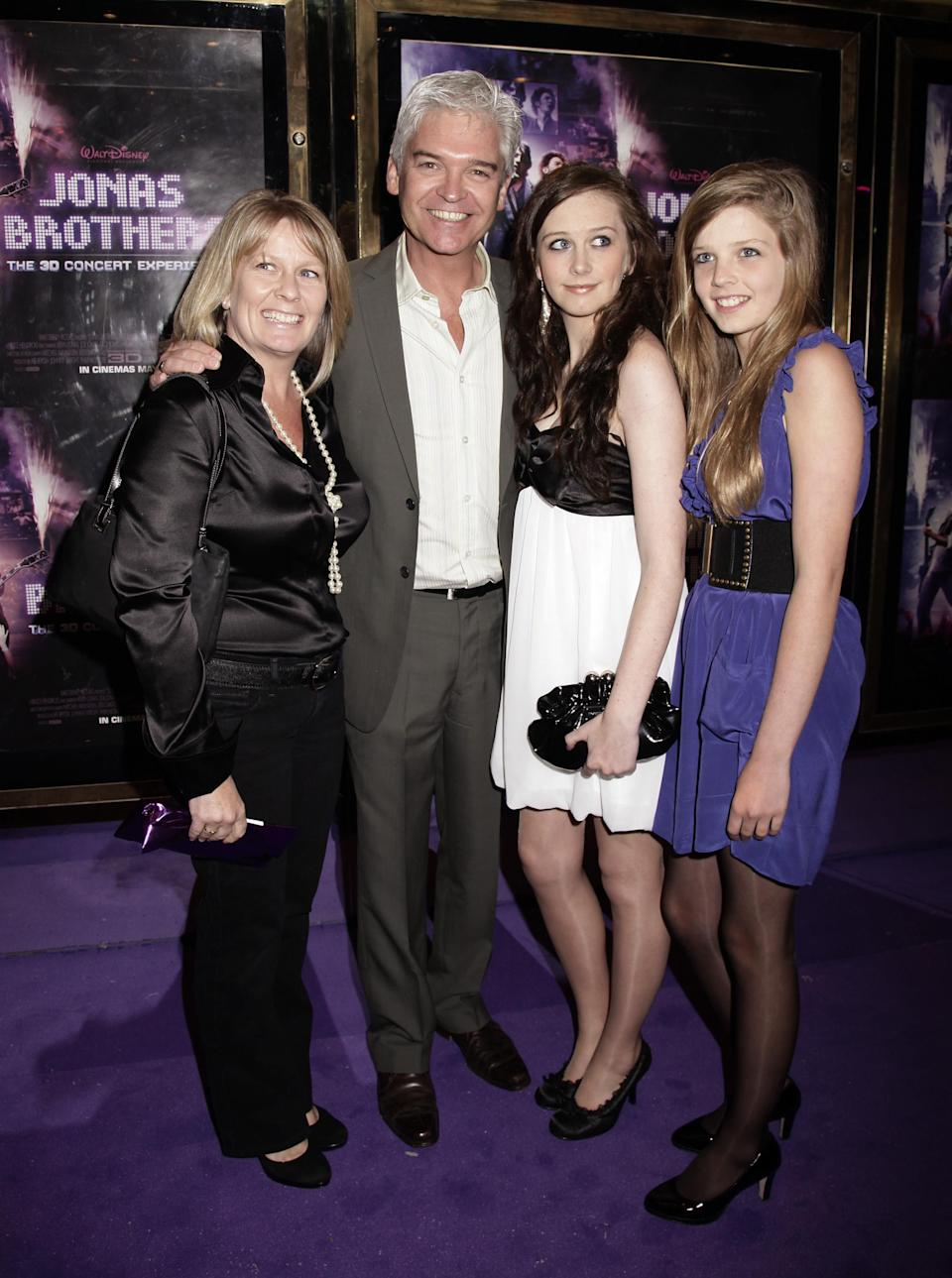 """File photo dated 13/05/09 of Phillip Schofield and family arriving for the premiere of 'Jonas Brothers: The 3D Concert Experience' at the Empire cinema in Leicester Square, London. Phillip Schofield has said he is """"coming to terms with the fact I am gay"""" in a statement on Instagram."""