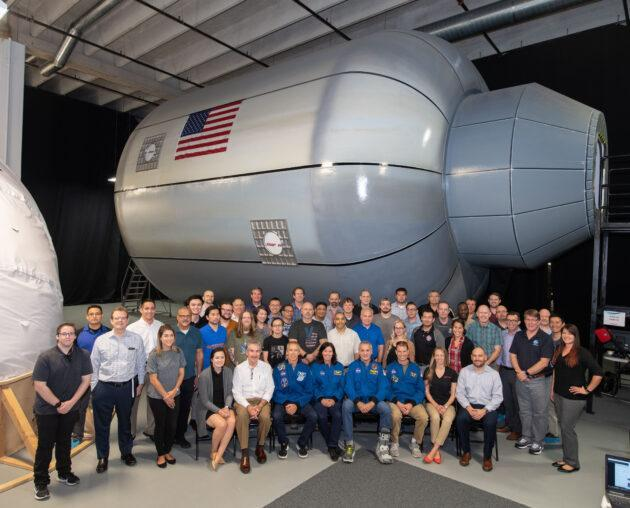The team for the NASA-Bigelow Aerospace habitat test lines up in front of the Bigelow Mars Transporter Testing Unit at the company's Nevada headquarters. (Bigelow Aerospace Photo)