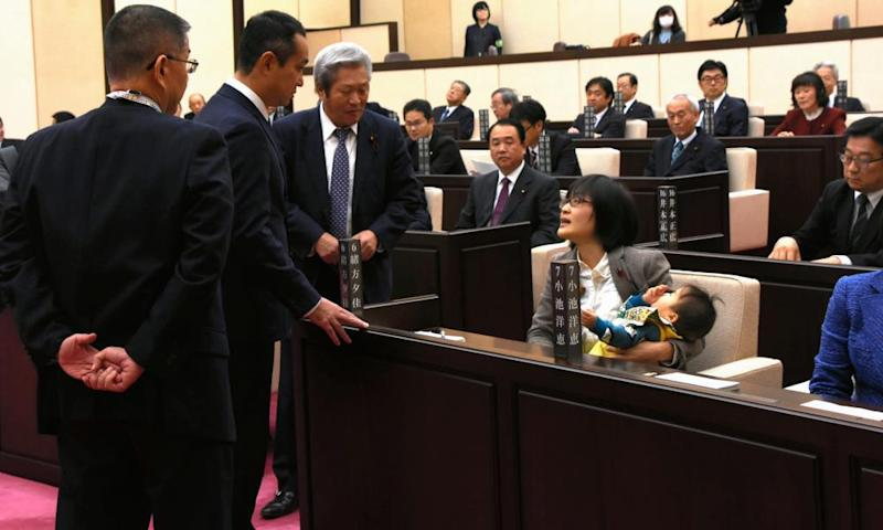 Yuka Ogata and her infant son in the chamber of Kumamoto municipal assembly.