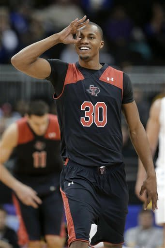 Texas Tech forward Jaye Crockett celebrates after making a 3-point shot during the first half an NCAA college basketball game against West Virginia in the Big 12 men's tournament Wednesday, March 13, 2013, in Kansas City, Mo. (AP Photo/Charlie Riedel)