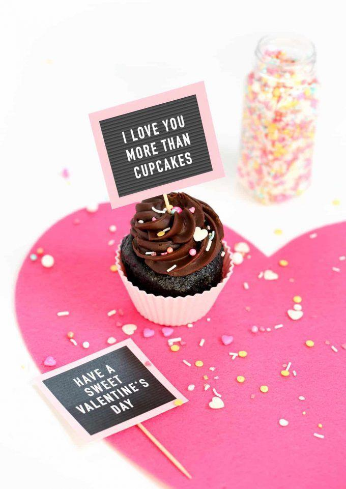 """<p>Talk about a trendy cupcake. There's no glue or paint required: Just download the printable, attach it to a toothpick, and enjoy!</p><p><a href=""""https://www.designeatrepeat.com/free-printable-valentine-cupcake-toppers-letterboard/"""" rel=""""nofollow noopener"""" target=""""_blank"""" data-ylk=""""slk:Get the tutorial at Design Eat Repeat »"""" class=""""link rapid-noclick-resp""""><em>Get the tutorial at Design Eat Repeat »</em> </a></p>"""