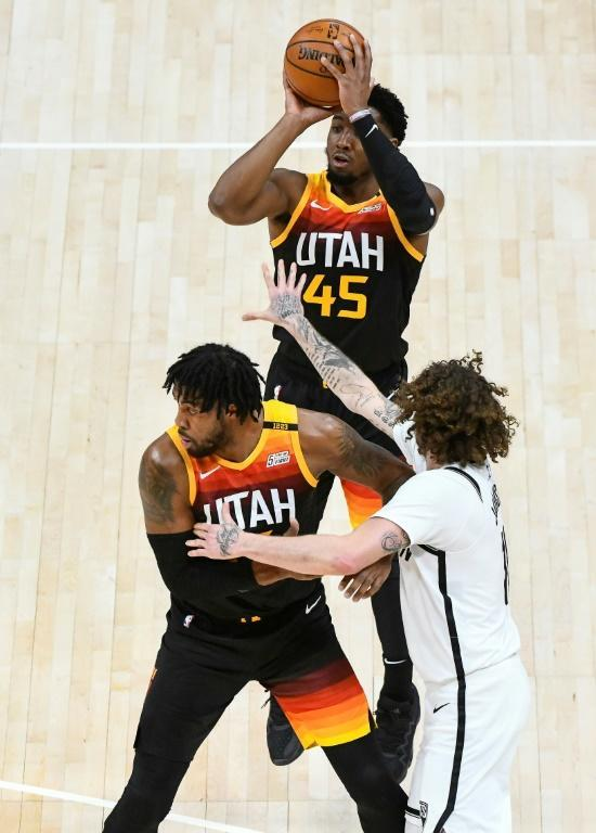 Utah's Donovan Mitchell shoots over Brooklyn's Tyler Johnson in the Jazz's 118-88 NBA victory over the Nets