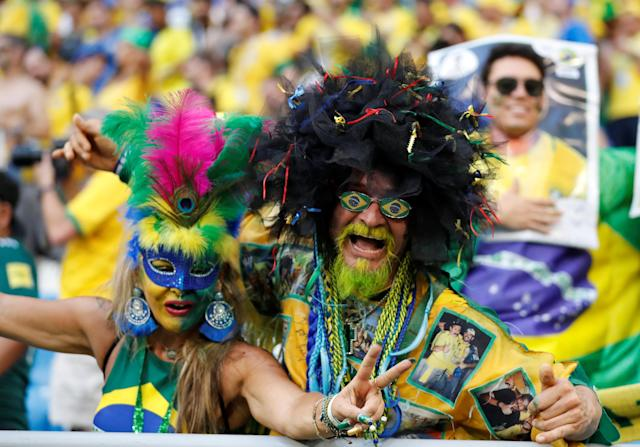 <p>Brazil fans celebrate after the match REUTERS/Carlos Garcia Rawlins </p>