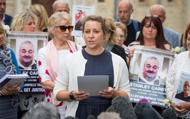 Bridget Reeves (centre), the granddaugher of Elsie Devine who died at Gosport War Memorial Hospital, and the families of other victims speak to the media outside Portsmouth Cathedral following the publication of the Gosport Independent Panel's report. - PA