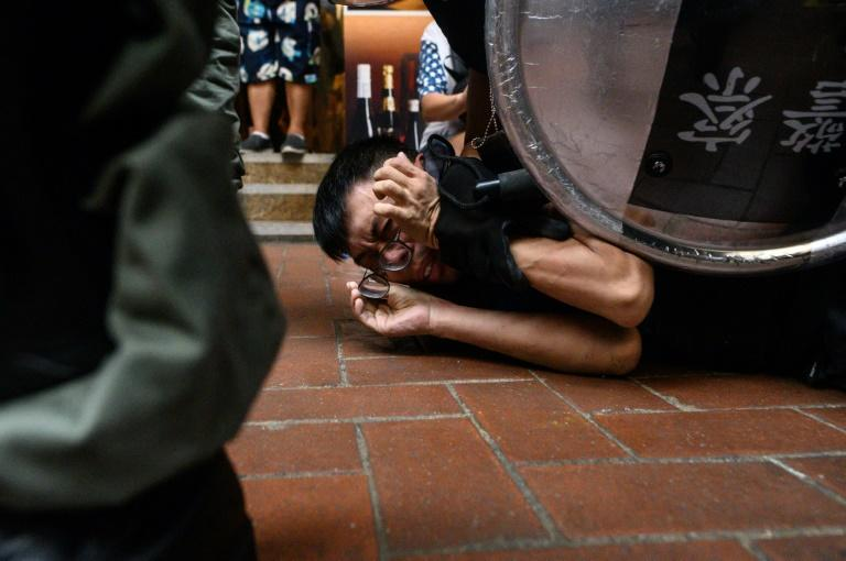 Hong Kong's summer of discontent was first triggered by an extradition bill to the mainland that has now been shelved (AFP Photo/Philip FONG)