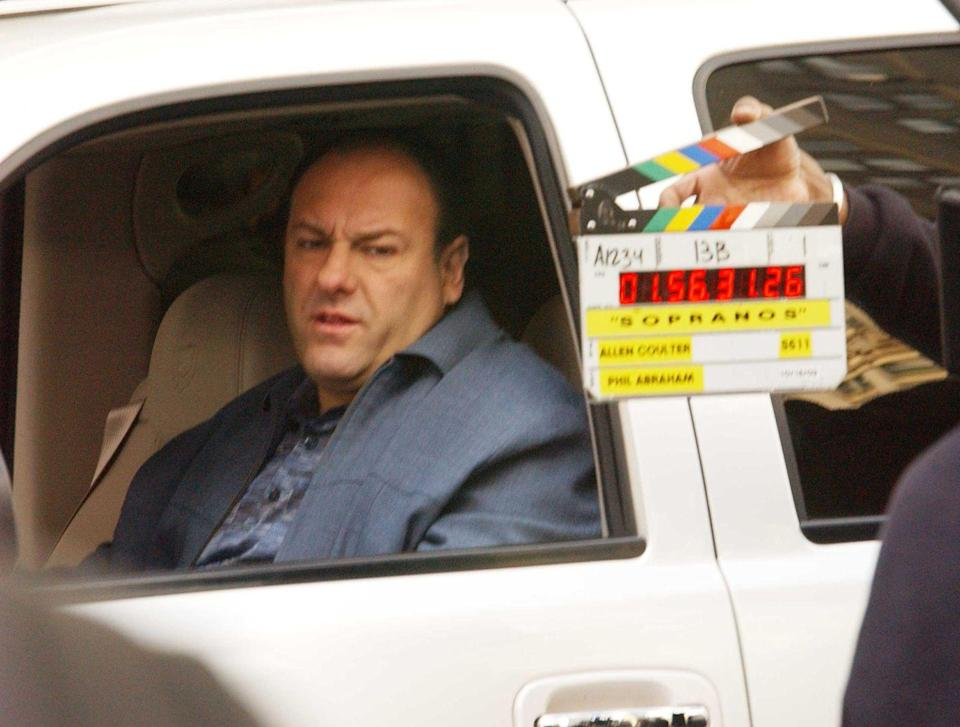 <p>James Gandolfini waits for his cue, while on set by The Plaza Hotel in New York City on October 15, 2003. </p>