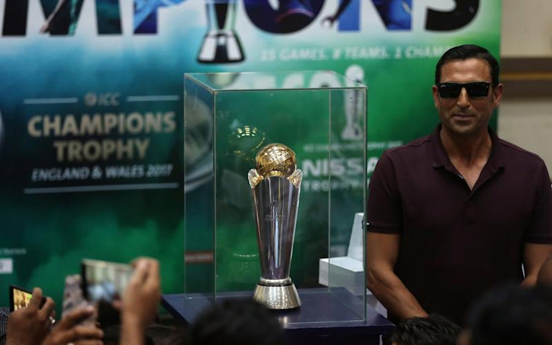 Pakistan's former cricket captain Younis Khan poses with the 2017 ICC Champions trophy - REUTERS