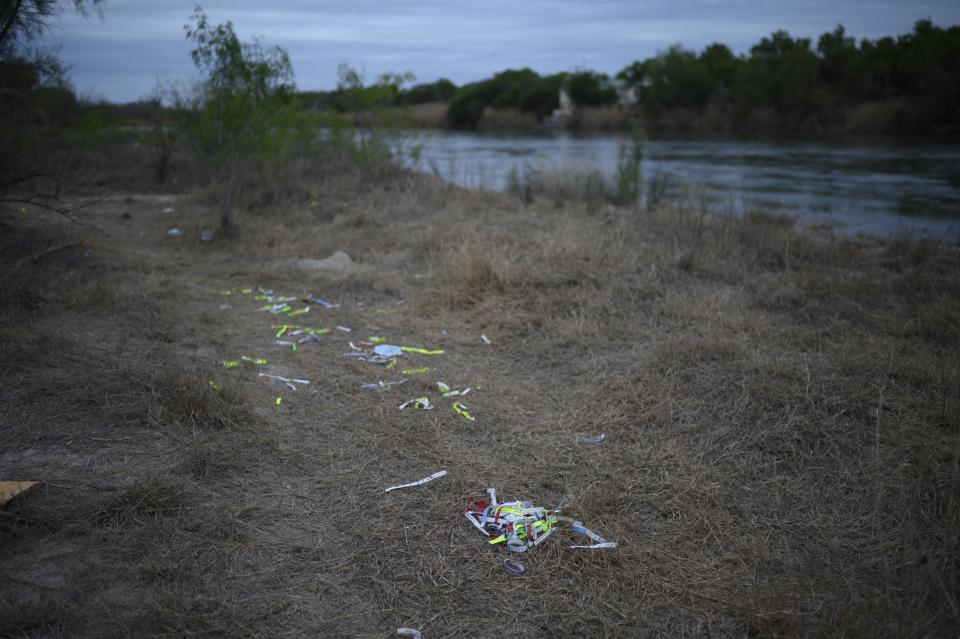 Bracelets used by 'coyote' people smugglers and inscribed with the names of immigrants who crossed illegally from Mexico to the US to seek asylum are discarded near the Rio Grande river.