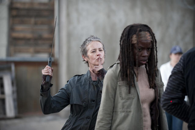 <p>Some people bring flowers, Melissa McBride brings a serrated machete for her surprise greeting for co-star Danai Gurira.<br><br>(Photo: AMC) </p>