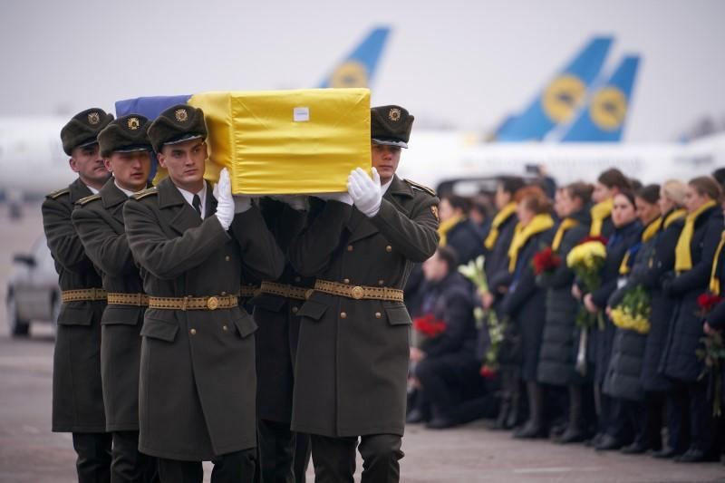 FILE PHOTO: Memorial ceremony for the Ukrainian victims of Iran plane crash at the Boryspil International Airport, outside Kiev