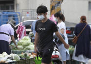 People wear face masks to help protect against the spread of the coronavirus as they shop in outdoor markets in Taipei, Taiwan, Monday, Sept. 27, 2021. (AP Photo/Chiang Ying-ying)