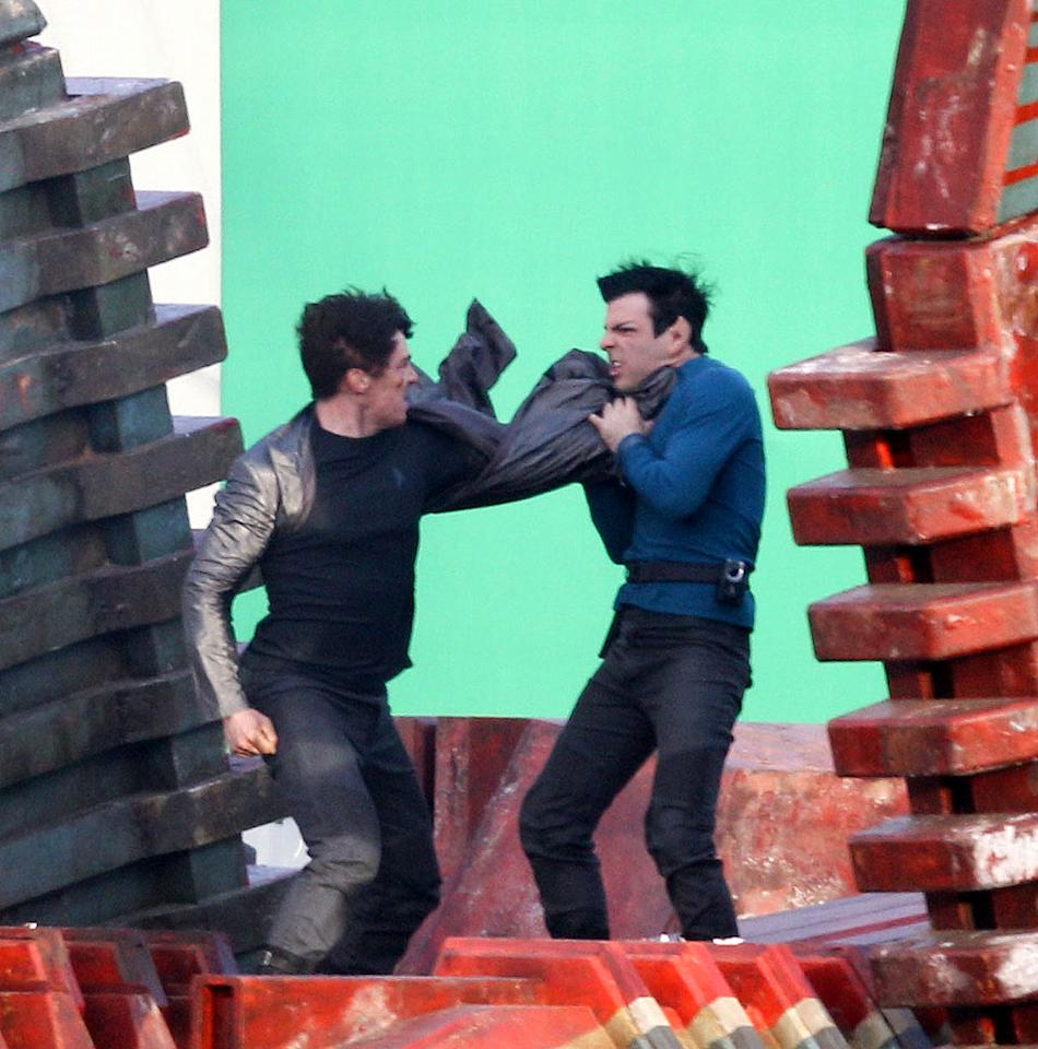 """The first images from the set of the highly anticipated Untitled Star Trek Sequel. The Top Secret plot of this film is partly revealed in these photos which show Zachary Quinto as Spock in a very intense fight with British Actor Benedict Cumberbatch who appears to be the film's Villain. Director JJ Abrams is seen on set meticulously choreographing & directing this very intense fight scene which took place on top of a moving Space Craft set. The set rotated 180 degrees during the fight scene with large green screens behind the actors. During the fight It appears that Spock is not successful against his adversary with his """"Vulcan Death Grip"""". Spock proceeds to get pummeled by the Villain who is wearing a black Star Fleet shirt."""