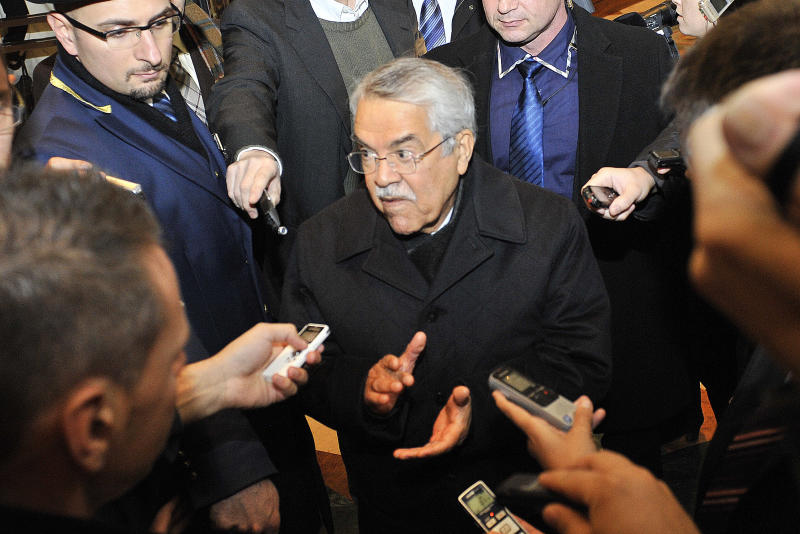 Saudi Arabia's Minister of Petroleum and Mineral Resources Ali Ibrahim Naimi arrives at a hotel for the Organization of the Petroleum Exporting Countries, OPEC, conference in Vienna, Austria, on Monday, Dec. 2, 2013. The Organization of Petroleum Exporting Countries will meet to decide on the cartel's oil output against a backdrop of slowing crude demand and unrest in member nation Libya. (AP Photo/Hans Punz)