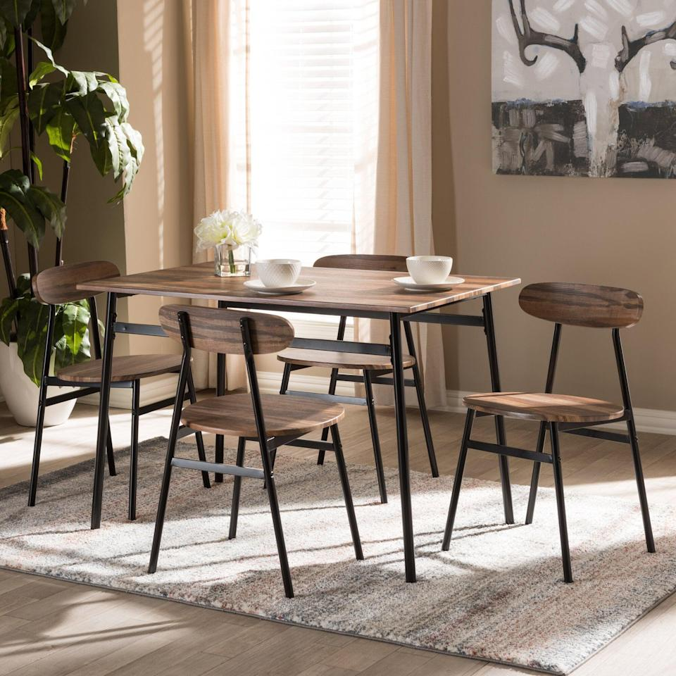 <p>This <span>Union Rustic Telauges 4-Person Dining Set</span> ($225, originally $290) blends elements of rustic and industrial style for a unique, mid-century look. The contrast of color also adds visual interest, while the metal frames make it durable investment.</p>