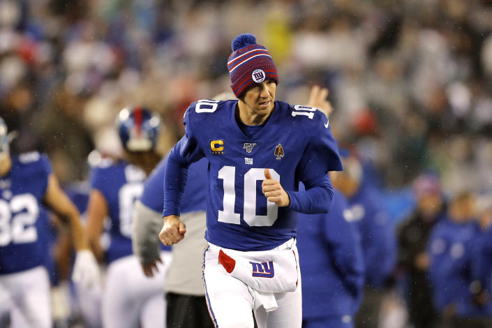 New York Giants quarterback Eli Manning (10) runs on the sideline in the second half of an NFL football game against Philadelphia Eagles on Sunday, Dec. 29, 2019, in East Rutherford, N.J. (AP Photo/Adam Hunger)