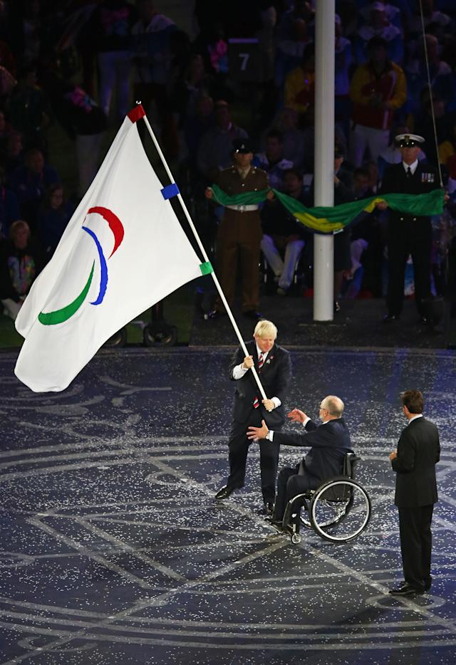 LONDON, ENGLAND - SEPTEMBER 09: Mayor of London Boris Johnson, President of the IPC Sir Philip Craven MBE and Mayor of Rio de Janeiro Eduardo Paes perform the Paralympic flag handover ceremony during the closing ceremony on day 11 of the London 2012 Paralympic Games at Olympic Stadium on September 9, 2012 in London, England. (Photo by Dean Mouhtaropoulos/Getty Images)
