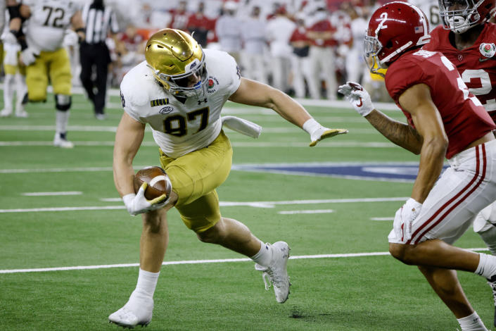 FILE - In this Jan. 1, 2021, file photo, Notre Dame tight end Michael Mayer (87) gains yardage after a catch as Alabama defensive back Patrick Surtain II (2) moves in to make the stop in the second half of the Rose Bowl NCAA college football game in Arlington, Texas. Offensive coordinator Tommy Rees has seen the offense come together behind quarterback Jack Coan, a grad transfer from Wisconsin, and preseason All-American candidates in running back Kyren Williams, tight end Michael Mayer, center Jarrett Patterson and guard Cain Madden, another grad transfer. (AP Photo/Michael Ainsworth, File)