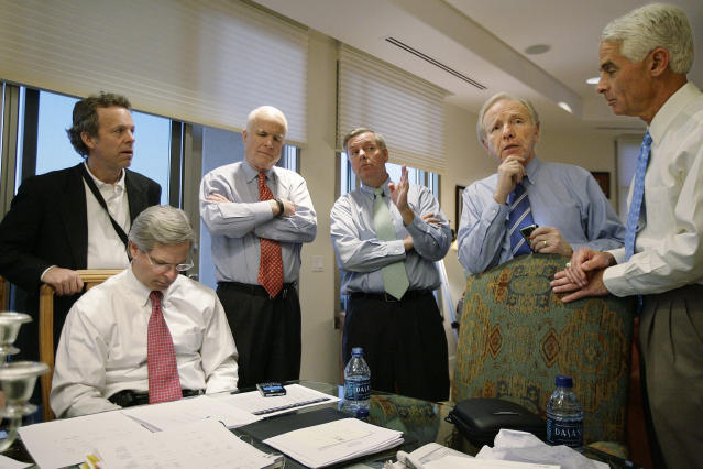 <p>Republican presidential hopeful Sen. John McCain, R-Ariz., is surrounded by staff and supporters at they monitor the Super Tuesday election returns at his home in Phoenix, Ariz., Feb. 5, 2008. From left are: advisor Mark McKinnon, campaign CEO Rick Davis, sitting, McCain, Sen. Lindsey Graham, R-S.C., Sen. Joseph Lieberman, I-Conn., and Florida Republican Gov. Charlie Crist. (Photo: Stephan Savoia/AP) </p>