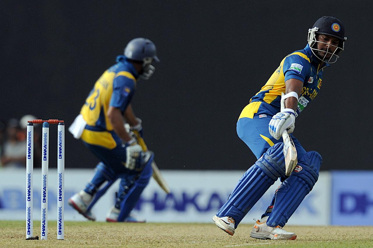 Sri Lankan cricketer Kumar Sangakkara (R) and Tillakaratne Dilshan run between wickets during the third and final one-day international (ODI) match between Sri Lanka and Bangladesh at The  Pallekele International Cricket Stadium in Pallekele on March 28, 2013. AFP PHOTO/ Ishara S. KODIKARA        (Photo credit should read Ishara S.KODIKARA/AFP/Getty Images)