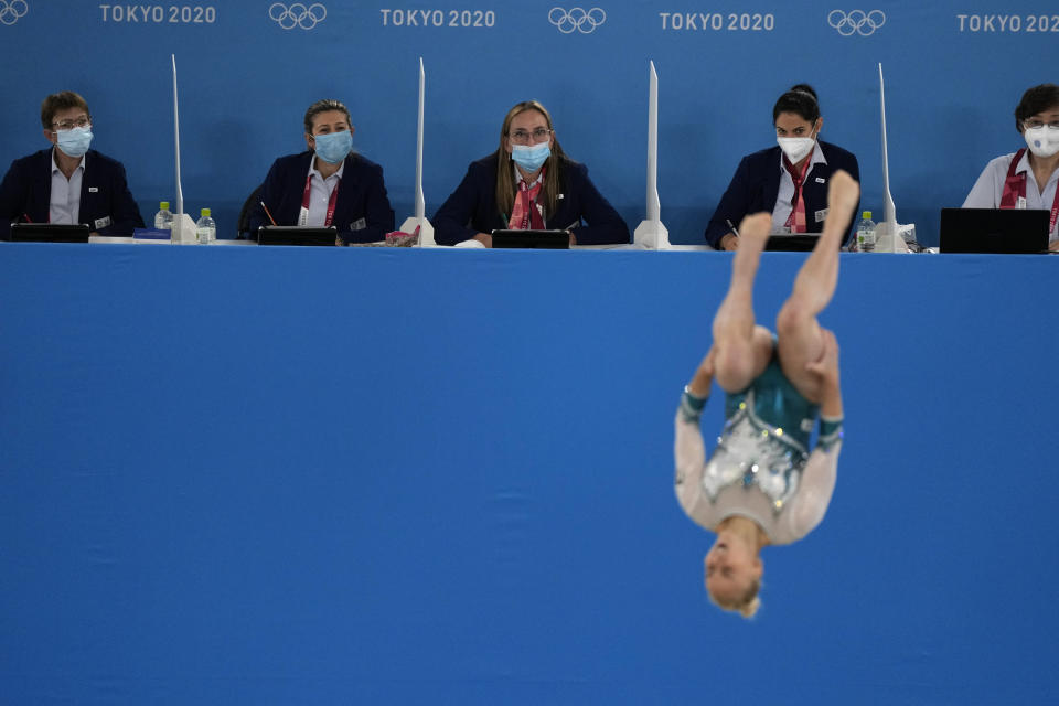 FILE - In this July 25, 2021, file photo, judges evaluate Asia D'Amato, of Italy, performing her floor exercise during the women's artistic gymnastic qualifications at the 2020 Summer Olympics in Tokyo. (AP Photo/Gregory Bull, File)