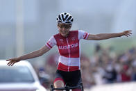 Anna Kiesenhofer of Austria, crosses the line solo to win the gold medal in the women's cycling road race at the 2020 Summer Olympics, Sunday, July 25, 2021, in Oyama, Japan. (AP Photo/Christophe Ena)