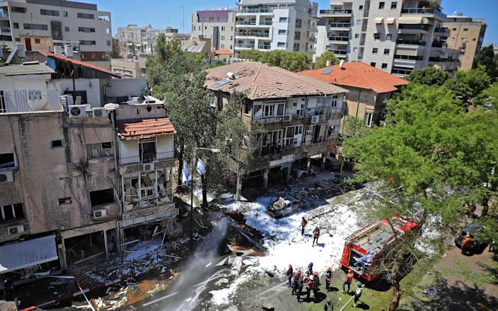 Members of Israeli security and emergency services work on a site hit by a rocket in Ramat Gan near Tel Aviv - Oren ZIV/AFP