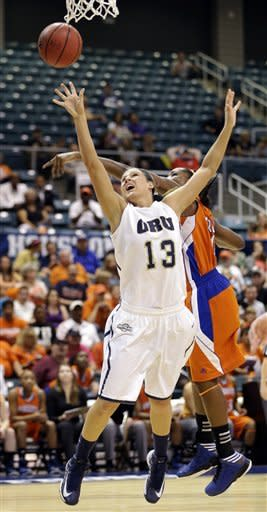 Oral Roberts' Savanna Buck (13) shoots as Sam Houston State's Sequeena Thomas defends during the first half of the Southland Conference championship NCAA college basketball game, Saturday, March 16, 2013, in Katy, Texas. (AP Photo/David J. Phillip)