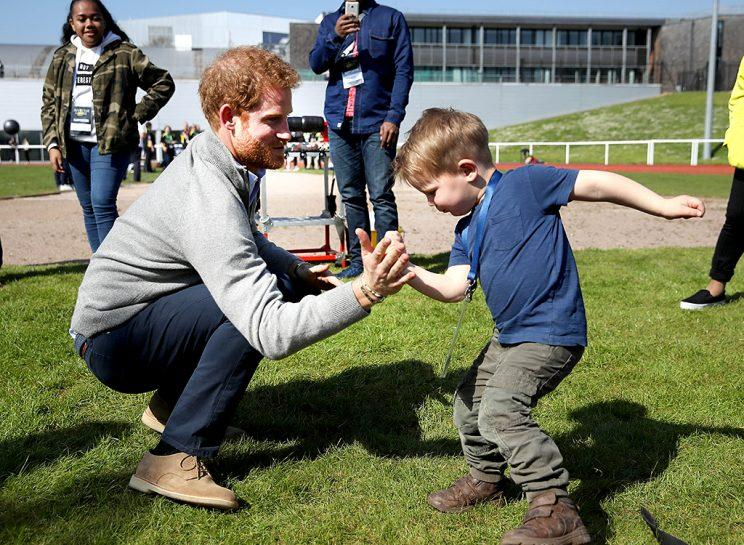 Prince Harry playing around with a young boy at the U.K. team trials for the Invictus Games.(Photo: KGC-375/STAR MAX/IPx)