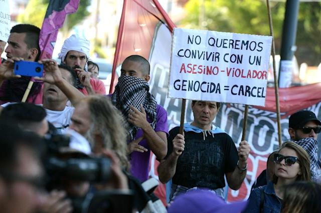 Activists protested outside the home where Miguel Etchecolatz was serving his detention for crimes against humanity, in Argentina's seaside resort of Mar del Plata (AFP Photo/Marina DEVO)