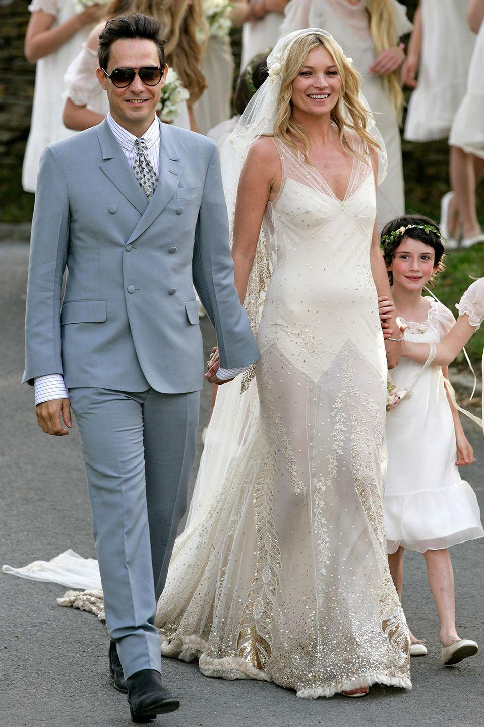 <p>Kate Moss built a career as a trendsetter, so of course her wedding dress wouldn't be any different. Her longtime friend and former Dior designer John Galliano made the supermodel a bohemian glam gown to tie the knot with rocker Jamie Hince. </p>