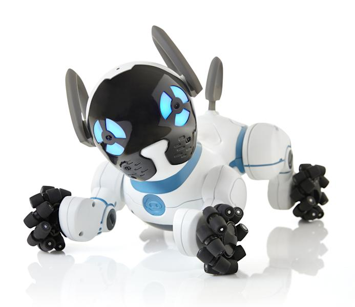 This photo provided by WowWee shows CHiP, a robot dog that cuddles, plays fetch and follows you around the house. Whether you're looking for something educational, or a toy that's just for fun, there are a lot of choices for the holidays. (Samuel Pasquier/Ariane Carrier-Cliche/Courtesy of WowWee via AP)
