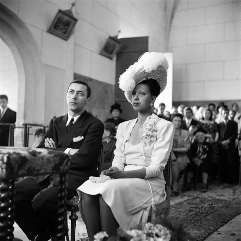 French US-born dancer and singer Josephine Baker and French conductor Jo Bouillon sit at their wedding mass in 1947 in the chapel of the Milandes Castle in Castelnaud-la-Chapelle, Dordogne, France.