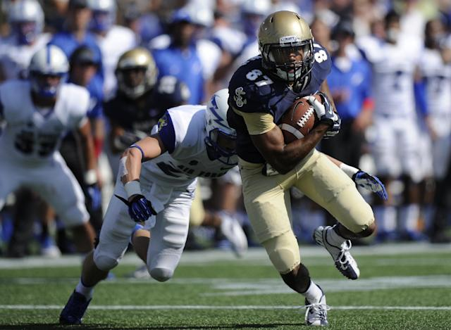 Navy wide receiver Shawn Lynch (87) runs with the ball against Air Force defensive back Gavin McHenry, left, during the second half of an NCAA football game, Saturday, Oct. 5, 2013, in Annapolis, Md. Navy won 28-10. (AP Photo/Nick Wass)