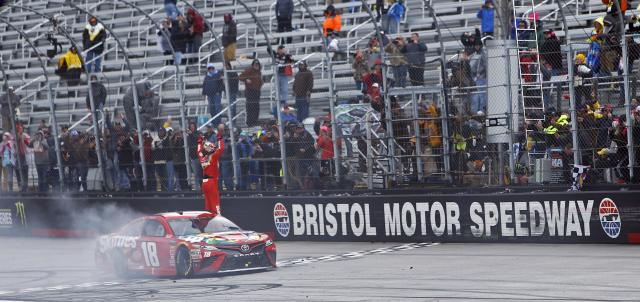 "<a class=""link rapid-noclick-resp"" href=""/nascar/sprint/drivers/947/"" data-ylk=""slk:Kyle Busch"">Kyle Busch</a> celebrates after winning during a NASCAR Cup Series auto race, Monday, April 16, 2018 in Bristol, Tenn. (AP Photo/Wade Payne)"