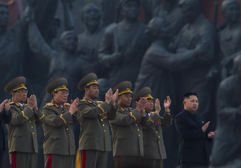 North Korean leader Kim Jong Un, far right, applauds with senior military officials at an unveiling ceremony for statues of the late leaders Kim Il Sung and Kim Jong Il in Pyongyang, North Korea, Friday, April 13, 2012. (AP Photo/David Guttenfelder)