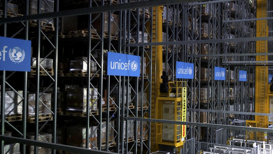 This image taken from video shows the inside of the UNICEF warehouse, the world's largest humanitarian aid warehouse, in Copenhagen, Denmark , Tuesday Oct. 13, 2020. For Burkina Faso, India, Venezuela and other countries with shaky health care delivery systems, the best chance for receiving scarce supplies of a coronavirus vaccine is through the Covax initiative, led by the World Health Organization and the Gavi vaccine alliance. UNICEF began laying the groundwork months ago in Copenhagen, at the world's largest humanitarian aid warehouse. (AP Photo)