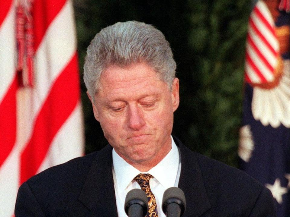 Bill Clinton apologises to the nation from the Rose Garden of the White House on 11 December 1998 in Washington, DC (WILLIAM PHILPOTT/AFP via Getty Images)