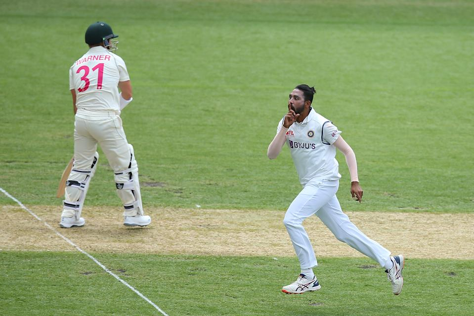 Mohammed Siraj of India celebrates after taking the wicket of David Warner of Australia during day one of the 3rd Test match in the series.