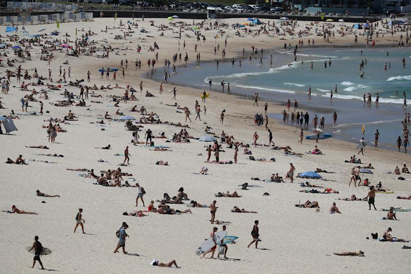 Beachgoers enjoy a sunny day at Bondi Beach despite growing concerns about the spread of the coronavirus disease (COVID-19) in Sydney, Australia, March 20, 2020. REUTERS/Loren Elliott