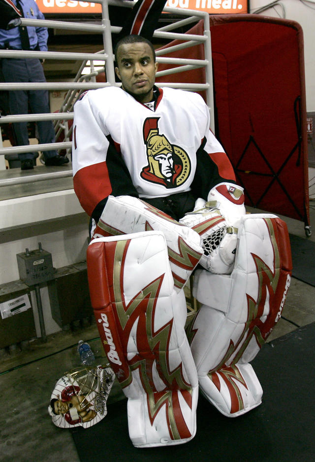 FILE - In this Dec. 12, 2007 file photo Ottawa Senators goalie Ray Emery watches during the third period of an NHL hockey game against the Carolina Hurricanes in Raleigh, N.C. Emery has drowned in his hometown of Hamilton, Ontario. He was 35. Hamilton Police confirmed Emery was identified as the victim of the swimming accident Sunday, July 15, 2018. (AP Photo/Gerry Broome)