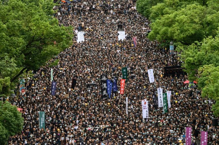 Thousands of university students started a boycott of classes with a mass rally in support of Hong Kong's anti-government protests (AFP Photo/Philip FONG)