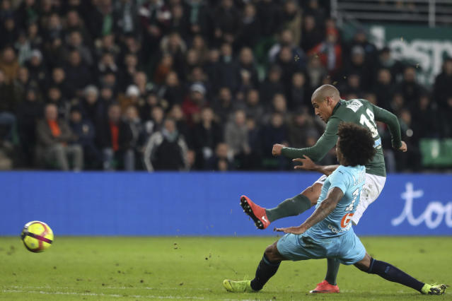 Saint-Etienne's Wahbi Khazri kicks the ball to score his second goal against Marseille during their French League One soccer match in Saint-Etienne, central France, Wednesday, Jan. 16, 2019. (AP Photo/Laurent Cipriani)