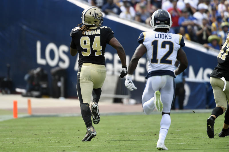 LOS ANGELES, CALIFORNIA - SEPTEMBER 15: Cameron Jordan #94 of the New Orleans Saints returns a fumble for a touchdown that was nullified due to the play being called an incomplete pass by the official against the Los Angeles Rams during the second quarter at Los Angeles Memorial Coliseum on September 15, 2019 in Los Angeles, California. (Photo by Kevork Djansezian/Getty Images)